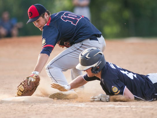 Dallastown's Eric Morrison tries to tag out Shiloh's