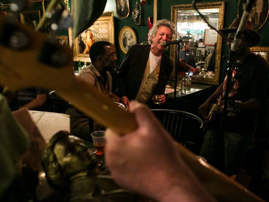 Mark Keller, 68, sings along with Carl and Co., a band