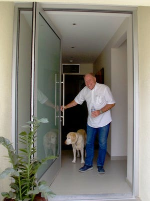 When Tom Steimel started renovating his patio home, one of the most important goals was to maximize natural light, starting with a custom frosted glass pivot door that fills the entire entryway.