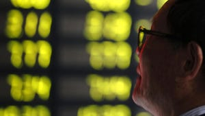 A man watches falling stock prices at a brokerage house in Shanghai on Monday, May 6, 2019.