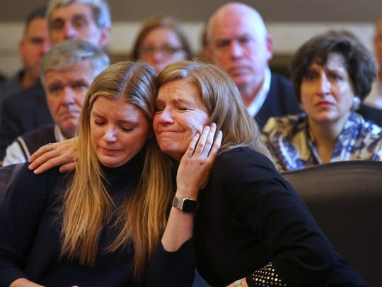 Mary Rust and her daughter, Katie, embrace as they listen to court proceedings during the guilty plea by Steven Sickle, 34.