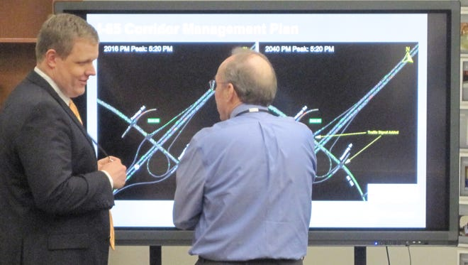Traffic consultant Stuart Day, left, and civil engineer Rocque Kneece discuss computer models of traffic flow at the I-85 Exit 40 interchang Tuesday in Powdersville..