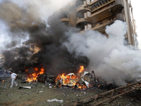 Burned cars are shown at the scene after two explosions struck near the Iranian Embassy killing many, in Beirut, Lebanon, on Nov. 19, 2013.