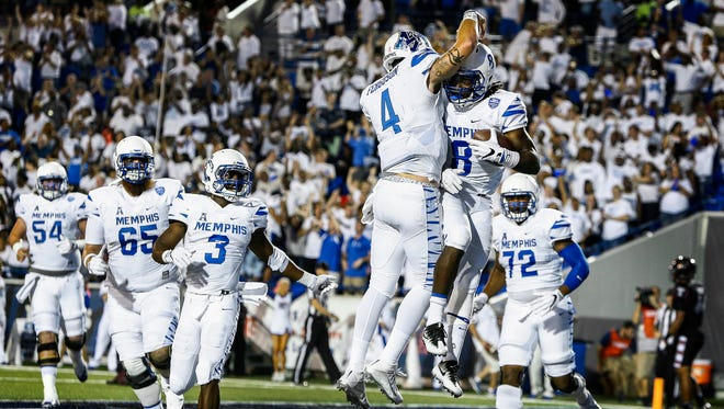 University of Memphis running backs  Darrell Henderson (left) celebrates with quarterback Riley Ferguson (left) after scoring a touchdown against Temple at Liberty Bowl Memorial Stadium on Oct. 6, 2016.