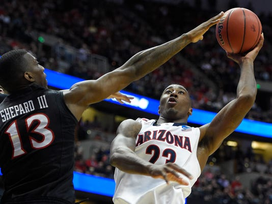 FILE - In this March 27, 2014, file photo, Arizona forward Rondae Hollis-Jefferson (23) shoots over San Diego State forward Winston Shepard (13) during the first half in a regional semifinal of the NCAA men's college basketball tournament in Anaheim, Calif. The second-ranked Wildcats are picked to repeat as Pac-12 champions. (AP Photo/Mark J. Terrill, File)