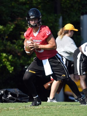 Southern Miss quarterback Jack Abraham prepares to throw the ball to their teammates during the first day of fall camp on Friday, August 3, 2018. Southern Miss' first game will be held in Hattiesburg on Saturday, September 1 against Jackson State.