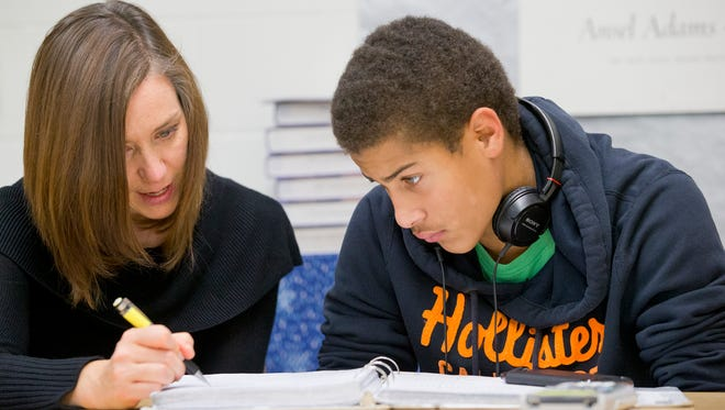 Ithaca High School math teacher Kerry Glenn-Keough of Ithaca, works with student Jordan Ayers of Ithaca. She is one of 23 Southern Tier public school teachers selected to New York's Master Teacher program.
