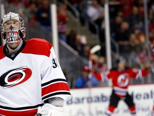 new styles 34832 249eb Schlemko scores late in 3rd, Devils beat Hurricanes 3-2