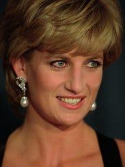 Princess Diana smiles at the United Cerebral Palsy