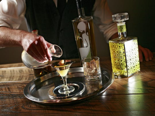 "Michael Gray shows the steps involved in creating one of the Libertine's signature drinks, ""The Preparation."""