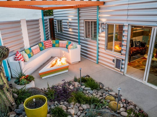 In a postage stamp yard designers utilized every inch for comfortable outdoor living all year round.