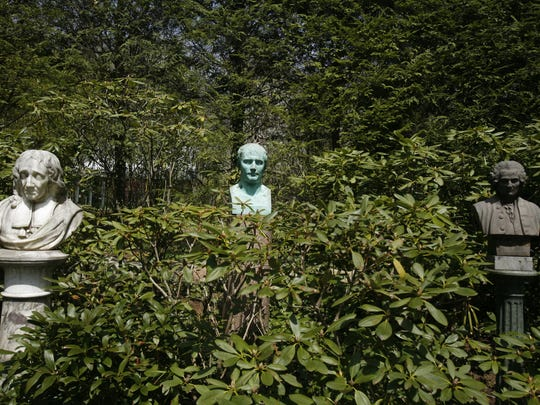 An 18th-century French statue, left, of John Milton, and a Napoleon statue in the circle garden at the White Garden in Lewisboro.