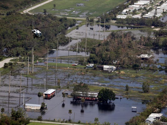 Marine One, with President Trump aboard, flies over areas impacted by Hurricane Irma, Thursday, Sept. 14, 2017, in Naples, Fla. (AP Photo/Evan Vucci)