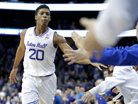 Seton Hall forward Desi Rodriguez (20) taps palms with fans during the second half of an NCAA college basketball game against Creighton, Thursday, Dec. 28, 2017, in Newark, N.J. (AP Photo/Julio Cortez)