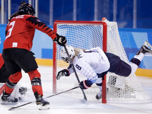 Emily Pfalzer (8), of the United States, collides with the post as Jocelyne Larocque (3), of Canada, defends during the second period of a preliminary round during a women's hockey game at the 2018 Winter Olympics in Gangneung, South Korea, Thursday, Feb. 15, 2018. Canada won 2-1. (AP Photo/Julio Cortez)