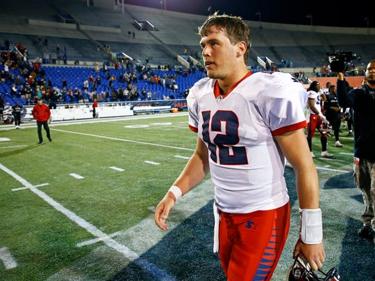 Memphis Express quarterback Brandon Silvers (12) leaves the field after a Birmingham Iron at Memphis Express AAF football game, Sunday, March 24, 2019, at Liberty Bowl Memorial Stadium in Memphis, Tenn. against the Memphis won in overtime 31-25. (AP Photo/Wade Payne)