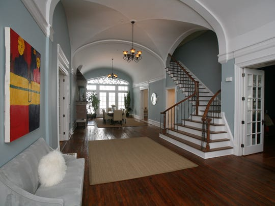 The large and grand center hall of an 1847 stone manor for sale in Sleepy Hollow.
