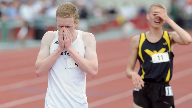 Fisher Catholic's Aaron Wood is overcome with emotion after finishing first in the 3,200 meter run during the Division III state final Saturday at Jesse Owens Memorial Stadium in Columbus.
