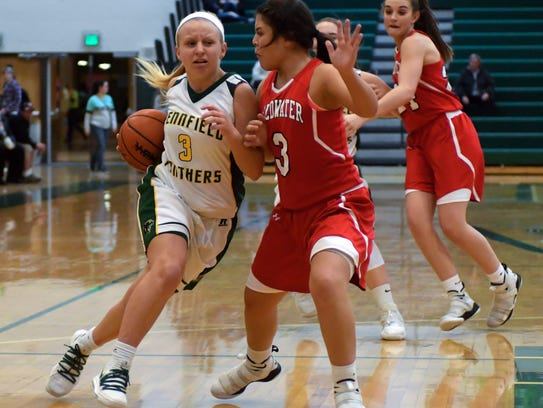 Pennfield's Naomi Davis (3) drives the basket early