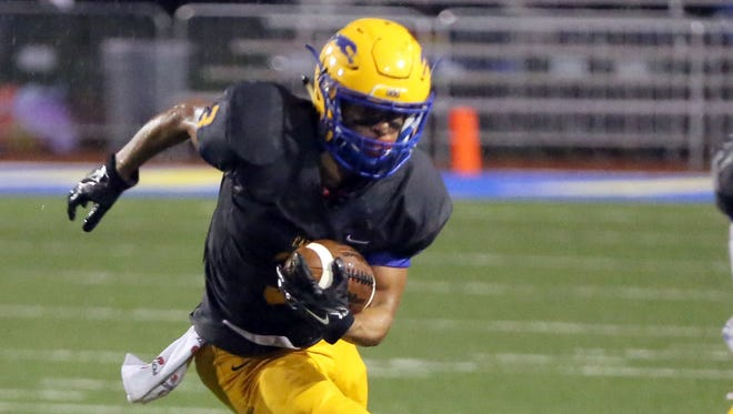 Jalen Walker carries the ball during the Greyhounds' 21-10 seminstate win over Penn on Friday night in Carmel.