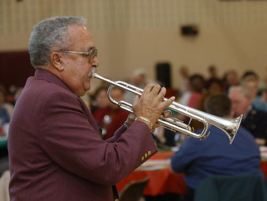 Melvin Harris plays Christmas music during the Salvation