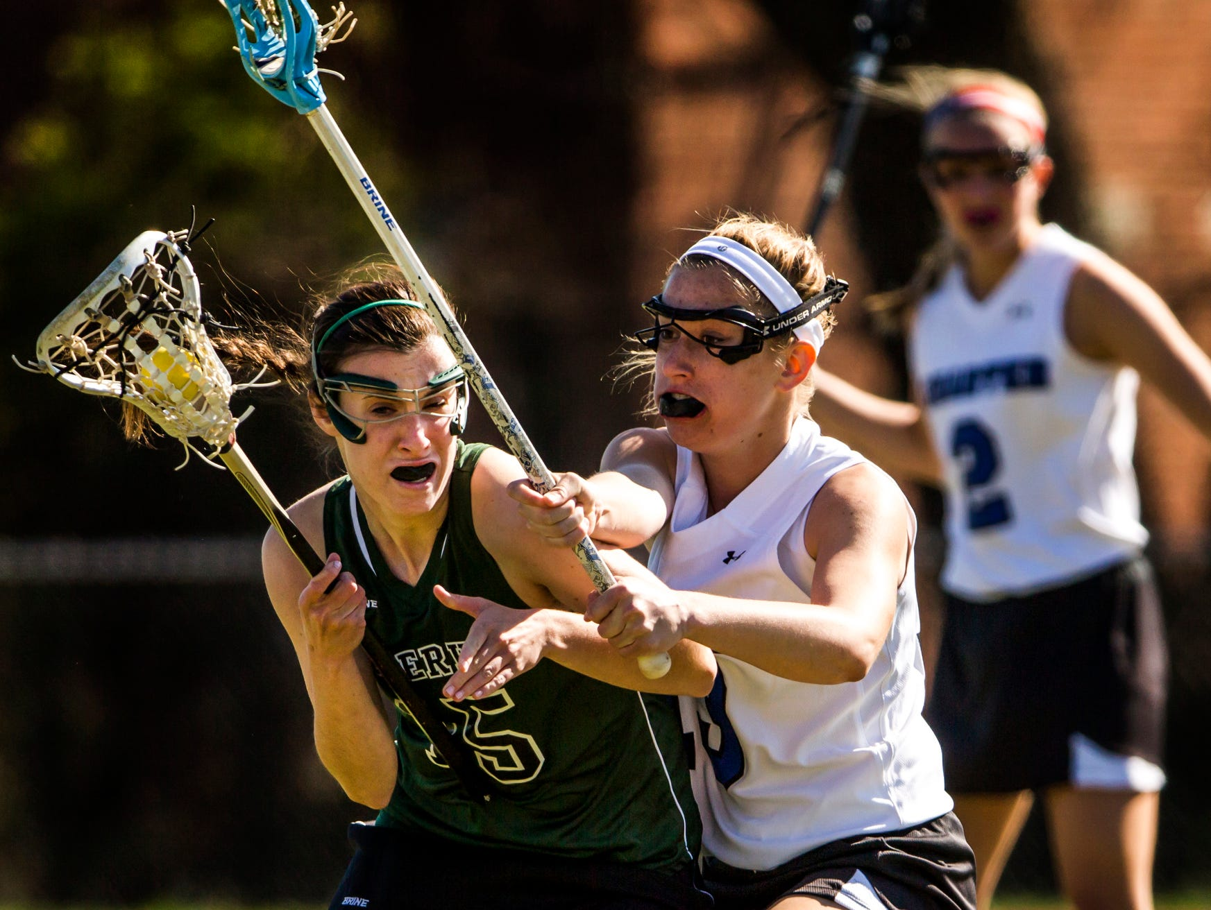 Charter's Jordan Wood (right) defends against Tower Hill's Sophie Peipher (left) in the first half of Charter's 10-9 win over Tower Hill at Charter School of Wilmington on Tuesday afternoon.