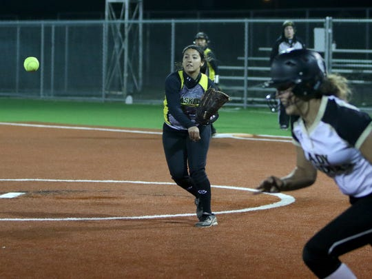 Haskell's Laura Fuentes throws to third as Rider's Madeline Naylor tries to make it back in time Saturday, March 4, 2017, at the Sunrise Optimist Complex.