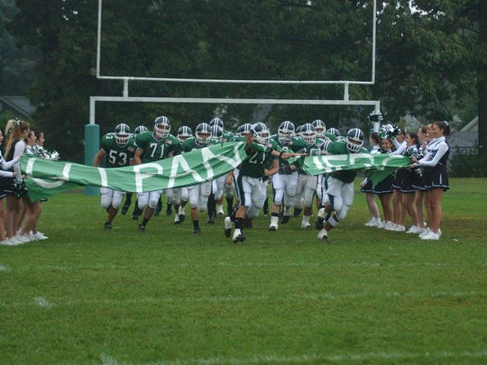In this 2003 photo, the Midland Park Panthers take the football field for a home game. They played on Santorine Field for the final time in 2005 before combining their program with Waldwick.