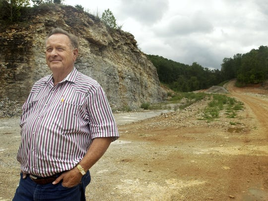 This 2006 photo shows Jerry Crawford, developer of Morningside in Blue Eye. Crawford had plans to create a waterfall over the rock bluff that is pictured behind him.