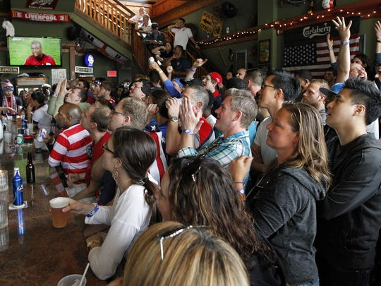 Fans cheer at Nomad World Pub during the 2014 World Cup. Team USA isn't in the tournament this year, but there are still parties all over town.