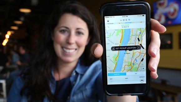 Jackie Rubbo, a Scarsdale resident who frequently uses the ride-sharing service Uber, shows the application on her mobile device at the Yonkers Brewing Company in Yonkers Sept. 14, 2015. She is part owner of the brewery.