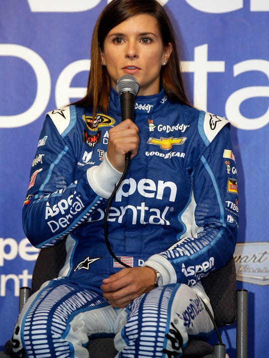 Danica Patrick talks to the media at a news conference before practice for the NASCAR Sprint Cup Series auto race at Chicagoland Speedway, Friday, Sept. 18, 2015, in Joliet, Ill. In an agreement announced Friday, Aspen Dental Management, Inc. (ADMI) has extended its partnership with Patrick and Stewart Haas Racing (SHR), doubling the number of races in which Aspen Dental serves as primary sponsor. (AP Photo/Nam Y. Huh)