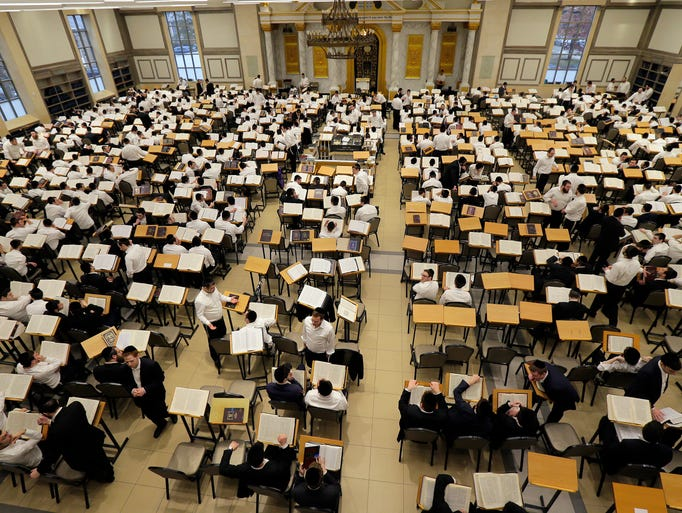 Students work in the study hall, which holds 1000 students,