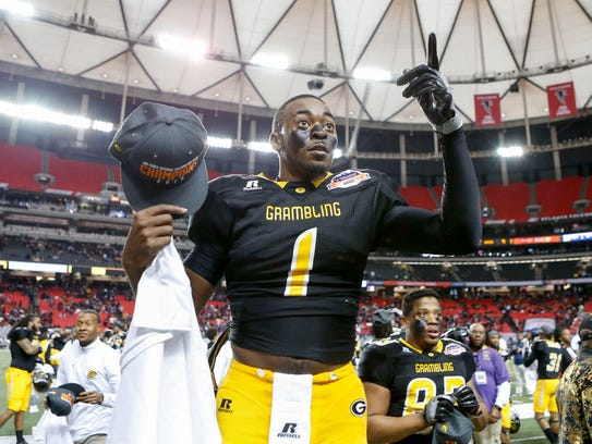 Grambling State quarterback Devante Kincade celebrates after defeating North Carolina Central in the 2016 Celebration Bowl at the Georgia Dome.