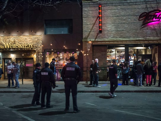 Police officers start to gather in front of The Whisk(e)y