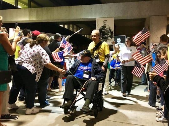 Veterans aboard a previous Honor Flight of Southern Indiana return from Washington D.C. to a Welcome Home Parade at Evansville Regional Airport.