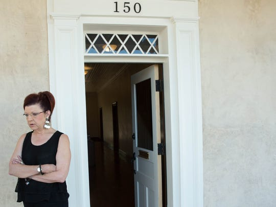 Debbi Moore, president and CEO of the Greater Las Cruces Chamber of Commerce, stands at the entrance to the historic  Armijo House on Lohman Ave. Wednesday Aug. 30, 2017. The Chamber  is in the final stages of  moving  into the home.