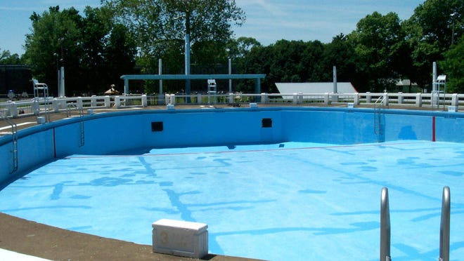 The oval-shaped pool at Brand Park Pool, as it appeared when this photo was taken in July 2001. It is about 50 yards long and 30 yards wide.
