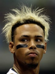 """All they do is laugh,"" Orlando Arcia says of his teammates' reaction to his wild hairdo."