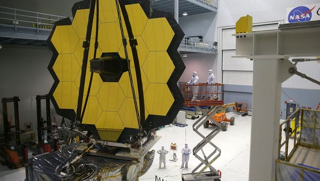 Engineers and technicians assemble the James Webb Space Telescope on Nov. 2, 2016, at NASA's Goddard Space Flight Center in Greenbelt, Md. Delays have pushed back a scheduled launch from 2018 to 2021.