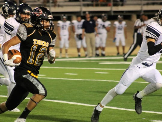 Alamogordo's Julio Mendoza turns up field during a