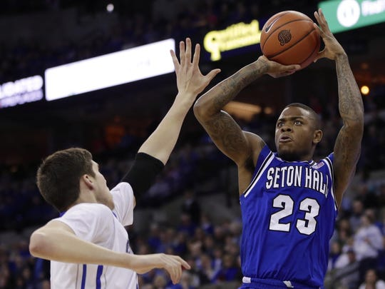 Seton Hall's Fuquan Edwin shoots over Creighton's Doug McDermott during a 2014 game.