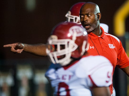 Lee head coach Tyrone Rogers coaches against Wetumpka at Hohenberg Field in Wetumpka, Ala. on Friday October 30, 2015. (Mickey Welsh / Montgomery Advertiser)