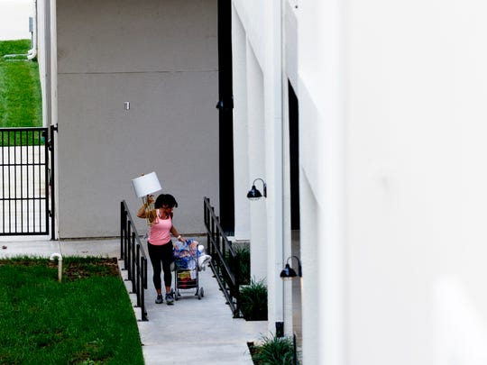 A resident carries their belongings to their apartment during move-in day at The Knox student housing on 1511 Clinch Ave. in Knoxville, Tennessee on Wednesday, August 16, 2017. The 101-room complex features a hot tub, outdoor seating area and grilling amenities.