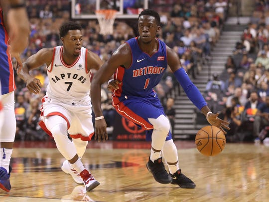 Pistons point guard Reggie Jackson (1) goes to the basket against Raptors point guard Kyle Lowry on Tuesday, Oct. 10, 2017, in Toronto.