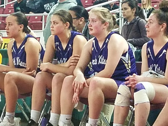 North Kitsap players (from left) Olivia Selembo, Erin