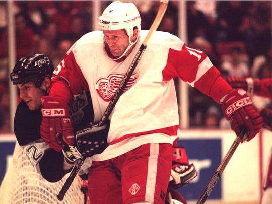 Detroit Red Wing #16 Vladimir Konstantinov tangles it up with LA Kings #22 Rick Tocchet during the game 1/12/96 at Joe Louis Arena.