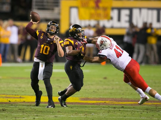 ASU quarterback Taylor Kelly passes as Utah linebacker Jared Norris defends and ASU running back Demario Richard blocks during the second quarter at Sun Devil Stadium in Tempe on Saturday, Nov. 1, 2014.