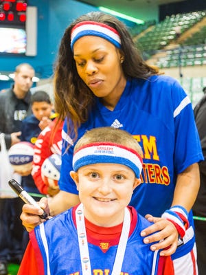 Chandler Moore has his Harlem Globetrotters jersey signed by Sweet J on Tuesday, Feb. 23 at the Wicomico Youth and Civic Center in Salisbury.