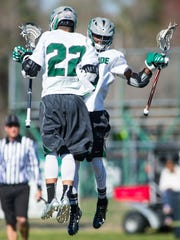 Parkside midfielder Jakob Keidel (22) celebrates a goal against Saints Peter & Paul with attackman Rashaan Evans (4) on Tuesday, March 29 at Parkside.